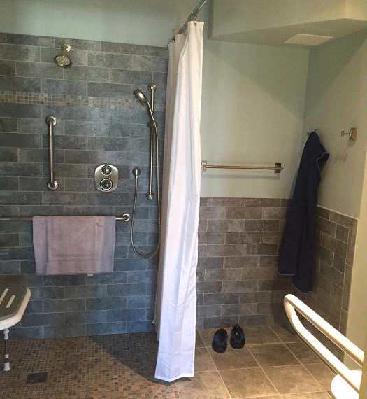 Wheelchair accessible shower, toilet, sink, and changing area