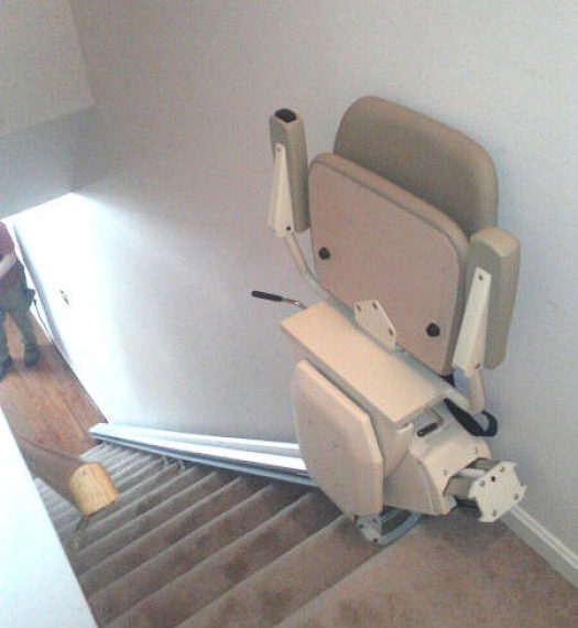 View of stair lift from top of stairs